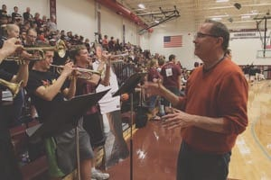 Newly appointed Bethel scramble band director Brad Shores leads a pep band made up of his students at Haven High School during the Bethel-Tabor game, the final one of the regular season, Feb. 20.