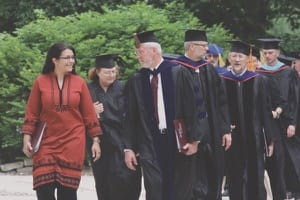 Aziza Hasan and then-interim president John K. Sheriff lead the faculty processional for commencement in 2010, when Hasan was the speaker.