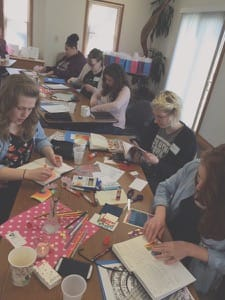 Bethel College students work on an art exercise, part of the faith formation portion of the Sister Care for College Women day that took place earlier in the semester.