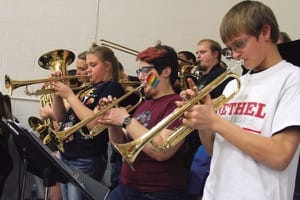 Bethel senior Abby Phillips, second from right, joined students from Haven High School to form a pep band, under the direction of Brad Shores, for the Bethel-Tabor basketball game last February.