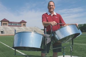 Brad Shores shows off some of his steel-drum chops with Thresher Stadium as the backdrop.