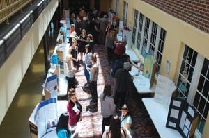 A display of student research set up in the Will Academic Center atrium this past spring as part of the URICA Symposium.