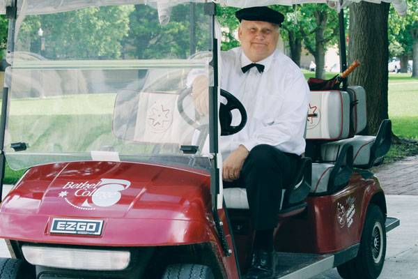 "Fred Goering cheerfully chauffeured people around campus in the Bethel College ""limo,"" and always dressed the part."