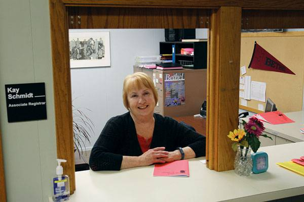 This is the view that many generations of students had of Kay Schmidt, associate registrar for 27 years, greeting them with a smile at the registrar's office window.