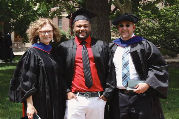 Sheldon Nunnally, center, with his Bethel social work professors, Ada Schmidt-Tieszen '74 and Hamilton Williams, at commencement