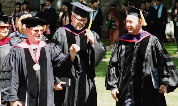 "One thing Brad Born especially enjoyed about being vice president for academic affairs was the ""ceremonial features."" He is pictured, center, at Commencement 2015 with President Perry D. White, left, and commencement speaker LaVerne Epp."