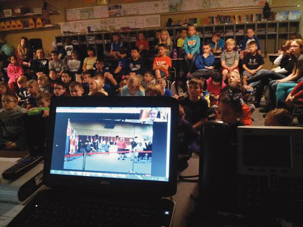 Fourth-graders from Wheatland Elementary School in Andover Skype® Dec. 4, 2014, with Larry Fisher, the Indonesian diplomatic interpreter for the U.S. State Department, about his trip to Asia with President Obama earlier that fall.