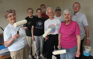 A group of alumni volunteers joins Dalene White in a volunteer project, painting in Warkentin Court. From left, Shirley (Suderman) Goering '57, Dianne (Waltner) Epp '61, White, Omer Galle '59, Berneil Rupp Mueller '62, Loren Reusser '59, Zona (Platt) Galle '58 and Ted Mueller '58.  Photo by Vada Snider.