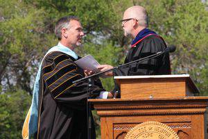 Allen Jantz '84 receiving his award from Brad Born '84. Photo by Vada Snider.
