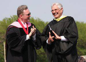 Perry White (left) with Dale Schrag during the Class of 2014 Commencement.  Photo by Vada Snider.