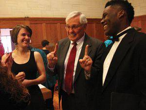 Dale Schrag talks with Audra Miller and Leland Brown III after Baccalaureate, May 18. Photo by Vada Snider.
