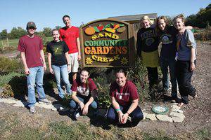 Student workers on Fall Service Day, from left, Brett Wedel, Natalie Unruh, Bryce Hostetler, Katrina Horner, Rachel Evans, Clarie Koehn, Martin Olson and Emily Wedel. Photo by Vada Snider.