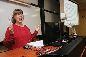 Lisa Janzen Scott '84, assistant professor of education and mathematics, uses PowerPoint in her Introduction to Math class. Photo by Vada Snider.