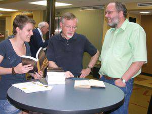 From left, Audra Miller, John Thiesen and Mark Jantzen at the book celebration for The Military Service Exemption of the Mennonites of Provincial Prussia. Photo by Melanie Zuercher