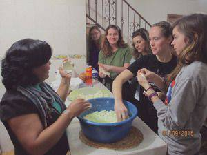 Bethel students learn to make pupusas, the ultimate Salvadoran comfort food, from an immigrant to Mexico from El Salvador (from left, Tia Goertzen, Koki Lane, unidentified non-Bethel student, Leah Mueller)