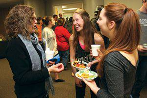 Ada Schmidt–Tieszen '74, left, talks with two first-year students in the group she is a hall parent for in Haury Hall, Katelyn Fatten, center, and Katherine Fry. Photo by Vada Snider.
