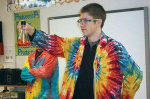 Dylan Jantz gets ready to show a class at Prairie Hills Middle School something 'aaaamazing' about chemistry. Photo by Teresa Poulseen.