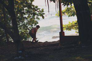 Senior Mariah Ekart chases iguanas to use in her class project