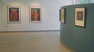 This photo, taken earlier this fall when 'Five Decades of Fun—The Artwork of John David Boyd' was on display in the Regier Gallery in Luyken Fine Arts Center, shows some of the work that Boyd's family later donated to Bethel College.  Photo by Melanie Zuercher.