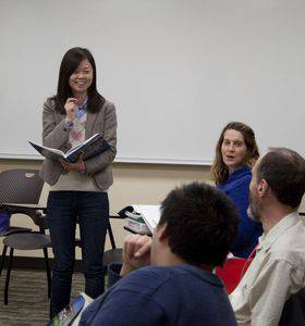 Lijun Zhu, left, works with the Mandarin Chinese class. Photo by Darrel Voth