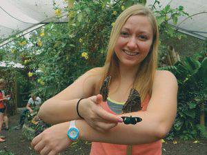Lisa Goering with a new friend in a mariposario (butterfly garden) in Mindo, Ecuador