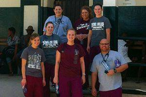 From left: front, Erin Regier, Lacy Smith  and Scott Musgrave; middle, Ashley Morris; back, Naura Harlow, Alexis Renteria and Erin Hilger, in front of the hospital in Hinche, Haiti