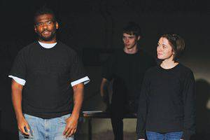 Lucky, an inmate of Hutchinson Correctional Facility, left, and Katie Schmidt, Bethel junior (with freshman Isaac Dunn in the background), rehearse a scene from Inside Story, which they performed at HCC in late January. Photo by Audra Miller.