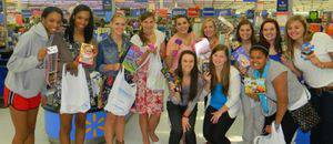 The women's basketball team took a group shopping trip in mid-October to the Newton Wal-Mart to buy items for their shoeboxes: (from left), Brittany Bates, Brianna Bates, Erin Doerksen, Jaime Tschetter, Kendra Scott, Jessica Ebenkamp, Katie Regier, Lauren Ulrich, Samantha Wilkerson, Ajai Brown, Haley Bright and Taylor Durant.