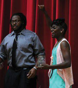 April Harpe accepts her THRESHPY Award for spirit from presenter Brandon Burrell.  Photo by Audra Miller.