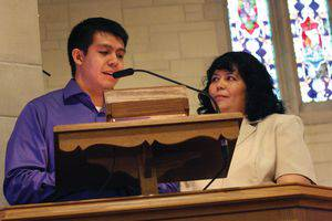 Danny Barrera and Rosa Barrera share reflections during the baccalaureate service.  Photo by Vada Snider.