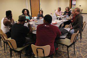 A group of students, faculty and staff meets in thevcafeteria to discuss issues of diversity on campus.  Photo by Vada Snider.