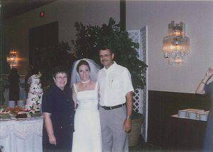 Delora and Jerry Decker with Susan Peschel Deraney on her wedding day, Aug. 19, 2000.